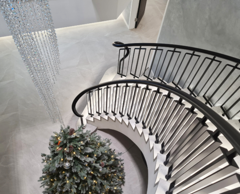 Curved stone staircase with bespoke posts