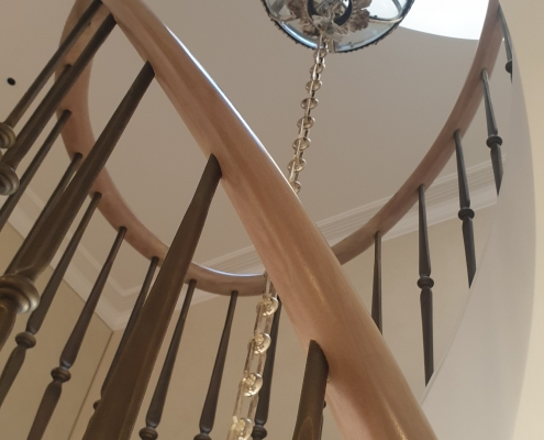 Bespoke timber handrail with brass finished steel spindles