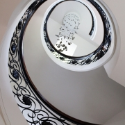 Sweeping staircase with bespoke timber handrail & steel balustrade