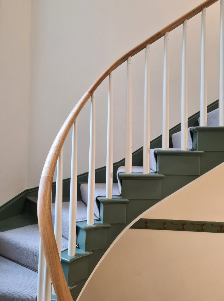 white painted tapered softwood spindles.