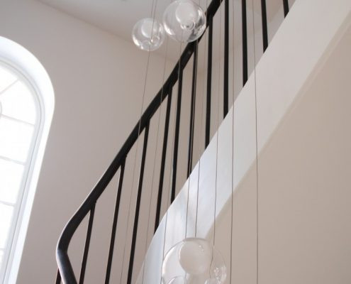 Sapele handrail with a French polished finish with steel rounded spindles